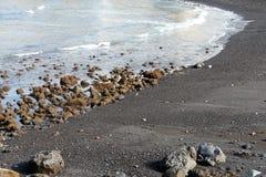 Svarta strandstenblock Royaltyfri Fotografi