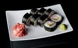 svarta sushi Fotografering för Bildbyråer