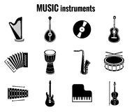 Svarta symboler för musikinstrument på vit bakgrund royaltyfri illustrationer