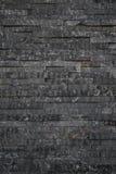 Svarta tegelstenar kritiserar textur Arkivfoton