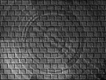svarta tegelstenar mönsan white Arkivbild