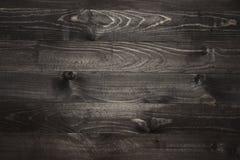 Svarta träplankor texturerade bakgrund Arkivfoton