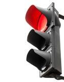 Svarta trafikljus med den röda signalen som isoleras på vit Arkivbild