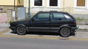Svarta Volkswagen Golf Arkivbild