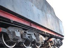 Svarthjul av en gammal USSR-lokomotiv Tappninghjul av en gammal sovjetisk fraktrailca arkivfoto