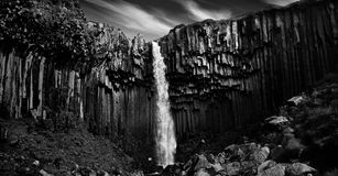 Svartifoss. Black waterfall. B&W. Svartifoss. Black waterfall. B&W. Iceland. Basalt columns as a result of volcanic activity Stock Photography