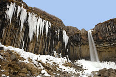Svartifoss. Surrounded by basalt columns and ice pinnacles, Skaftafell National Park, Iceland Winter Stock Photography