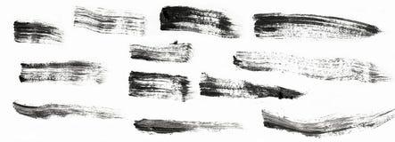 Svartslaglängder av den isolerade målarfärgborsten, färgstänk av isolerade målarfärgslaglängder Royaltyfri Foto