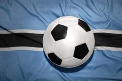 Svartvit fotbollboll på nationsflaggan av Botswana Arkivbilder
