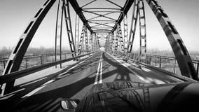 Svartvit längd i fot räknat: bilen flyttar sig vid bron stock video