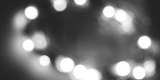 Svartvit unfocused ljusbakgrund Royaltyfria Bilder