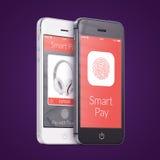 Svartvita smartphones med smart lönapplikation på scen Arkivfoton