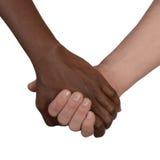 Svartvitt handförälskelsepartnerskap fotografering för bildbyråer