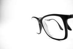 Svartvitt slut för exponeringsglas upp Vit bakgrund Arkivfoto