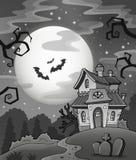 Svartvitt spökat hus Arkivfoton