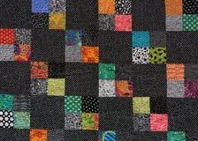 Svartvitt täcke med fyrkanter av färg Royaltyfri Foto