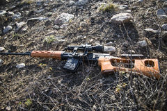 SVD sniper rifle lying on the ground. Royalty Free Stock Image