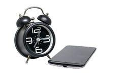 Sveglia e smartphone immagine stock libera da diritti