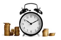 Sveglia e soldi Immagini Stock