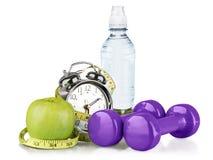 Sveglia verde, mela, bottiglia di acqua Fotografia Stock Libera da Diritti