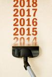 Svepande år nummer 2014 för dammsugare från matta Fotografering för Bildbyråer