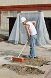 svepande arbetare för smuts Arkivbilder