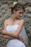 Sveta one. The bride in the white costs against a brown wall Stock Photo