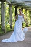 Sveta and umbrella. The smiling bride in a white dress with an umbrella in park Royalty Free Stock Photography