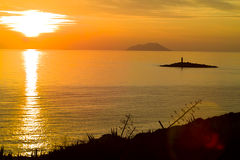 Svetac and Vis island at sunset Royalty Free Stock Photo