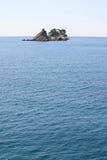 Sveti Nedelja Island. Islands Sveti Nedelja and Katic in Adriatic sea. Petrovac na moru. Montenegro Royalty Free Stock Photography