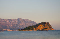 Sveti Nikola island and mountains at sunset . Stock Images