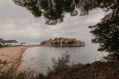 Sveti Stefan historical town island and paradise sand beach. Budva, Montenegro royalty free stock image
