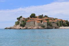 Sveti Stefan island in a beautiful summer day, Montenegro stock photography