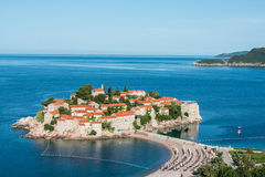Sveti Stefan island, Budva, Montenegro. Sveti Stefan, now Aman Sveti Stefan is a small islet and hotel resort in Montenegro, approximately 6 kilometres (3.7 mi) Stock Images