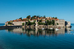 Sveti Stefan island, Budva, Montenegro. Sveti Stefan, now Aman Sveti Stefan is a small islet and hotel resort in Montenegro, approximately 6 kilometres (3.7 mi) Stock Photography