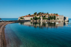 Sveti Stefan island, Budva, Montenegro. Sveti Stefan, now Aman Sveti Stefan is a small islet and hotel resort in Montenegro, approximately 6 kilometres (3.7 mi) Stock Photos