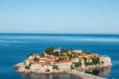 Sveti Stefan island, Budva, Montenegro. Sveti Stefan, now Aman Sveti Stefan is a small islet and hotel resort in Montenegro, approximately 6 kilometres (3.7 mi) Stock Image