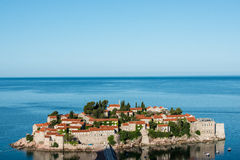 Sveti Stefan island, Budva, Montenegro. Sveti Stefan, now Aman Sveti Stefan is a small islet and hotel resort in Montenegro, approximately 6 kilometres (3.7 mi) Stock Photo