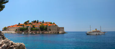 Sveti Stefan and yacht stock image
