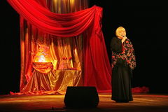 Svetlana Kryuchkova on the Estrada theatre stage singing and reading poetry. Stock Images