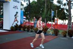 Svetlana Zakharova wins 2009 Honolulu Marathon. 39-year-old Russian female athlete Svetlana Zakharova seconds after crossing the finish line in 2 hours, 28 Stock Images