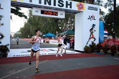 Svetlana Zakharova wint de Marathon van Honolulu Stock Foto's