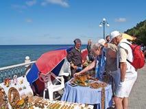 SVETLOGORSK, RUSSIA. The elderly woman buys an amber souvenir. SVETLOGORSK, RUSSIA - AUGUST 23, 2009: The elderly woman buys an amber souvenir Stock Photography