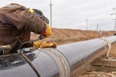 Svetsning arbetar på gasledningen royaltyfri foto