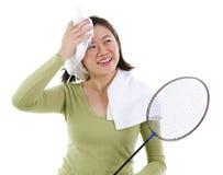 Svettas efter badminton Arkivfoto