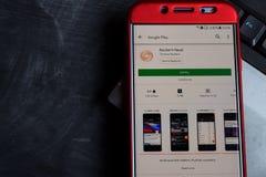 Sviluppatore app di notizie Reuters sullo schermo di Smartphone immagini stock libere da diritti