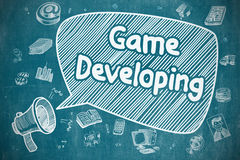 Sviluppo del gioco - illustrazione di scarabocchio sulla lavagna blu Fotografia Stock