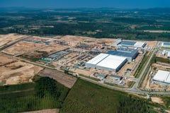 Sviluppo del territorio della zona industriale e vista aerea della costruzione Immagini Stock Libere da Diritti