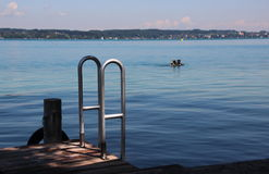 Svimmers Pier with Steel Ladder and Scuba Divers Royalty Free Stock Image