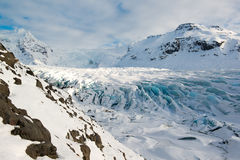 Svinafellsjokull glacier tongue in winter, blue ice covered by snow, Iceland Royalty Free Stock Photos